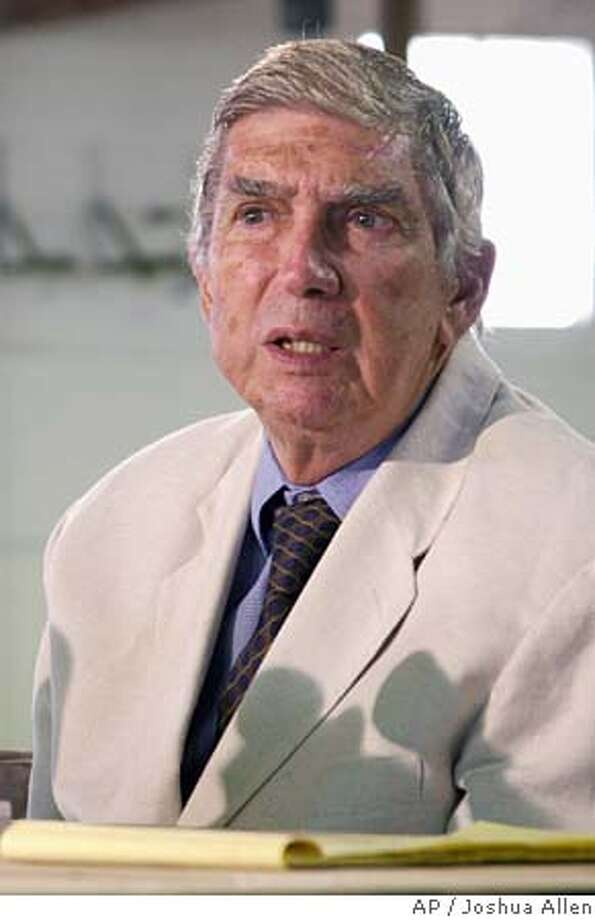 Luis Posada Carriles listens to a question by a reporter during a news conference, Tuesday, May 17, 2005 in Hialeah, Fla. Carriles, a 77-year-old former CIA operative and Venezuelan security official, was taken into custody by Homeland Security authorities. (AP Photo/Joshua Allen) Photo: JOSHUA ALLEN