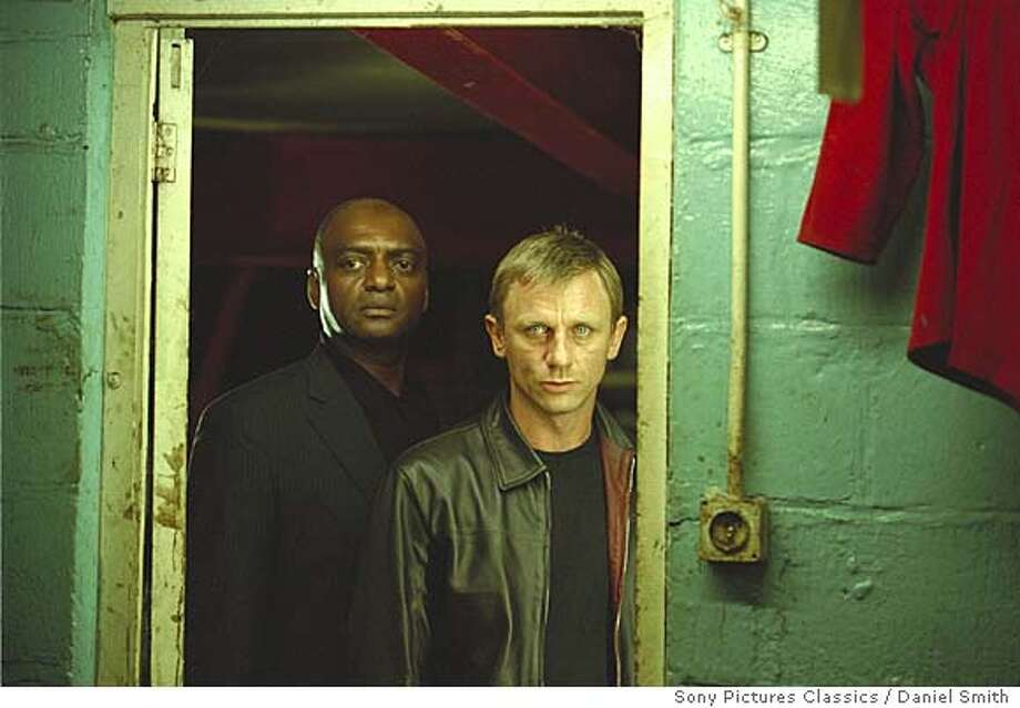 """In this photo provided by Sony Pictures Classics, """"Morty"""" (George Harris, left) and """"XXXX"""" (Daniel Craig) are involved in the underworld of an international drug ring in """"Layer Cake."""" (Sony Pictures Classics/Daniel Smith) . HANDOUT PHOTO PROVIDED BY SONY PICTURES CLASSICS. Photo: DANIEL SMITH"""