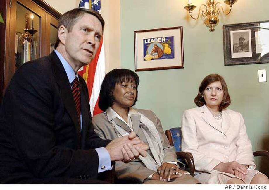 Senate Majority Leader Bill Frist poses for pictures on Capitol Hill Tuesday, May 17, 2005, with judicial nominees Janice Rogers Brown, center, and Pricilla Owen. The Senate's top leaders have ended their attempt to find a compromise on President Bush's stalled judicial nominees, but other members continued to work on a possible deal to clear five blocked appeals court appointees and end threats to change the long-standing filibuster rules. (AP Photo/Dennis Cook) Ran on: 05-18-2005  Senate Majority Leader Bill Frist poses with Janice Rogers Brown (center) Priscilla Owen, both of whom Democrats oppose. Ran on: 05-18-2005  Senate Majority Leader Bill Frist poses with Janice Rogers Brown (center) and Priscilla Owen, both of whom Democrats oppose. Ran on: 05-18-2005 Photo: DENNIS COOK