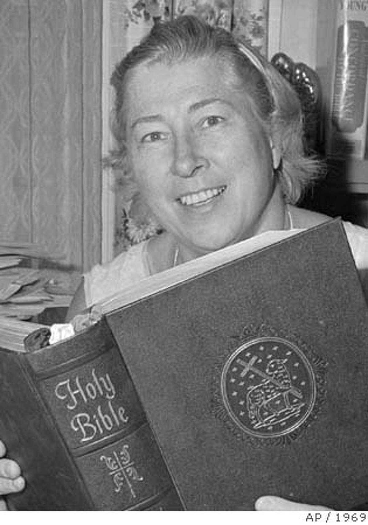 FILE -- Madeline Murray O'Hair holds a copy of the Bible in her Austin, Texas, office Dec. 3, 1969 after her suit to prohibit astronauts from praying and reading the Bible aloud in space had been thrown out by a federal court. America's most prominent atheist hasn't been seen in public for weeks, giving rise to rumors that she has died and that her followers are keeping it quiet so that Christians don't pray over her. (AP Photo/FILE/Ted Powers)MADALYN MURRAY O'HAIR ALSO RAN 1/12/99 CAT