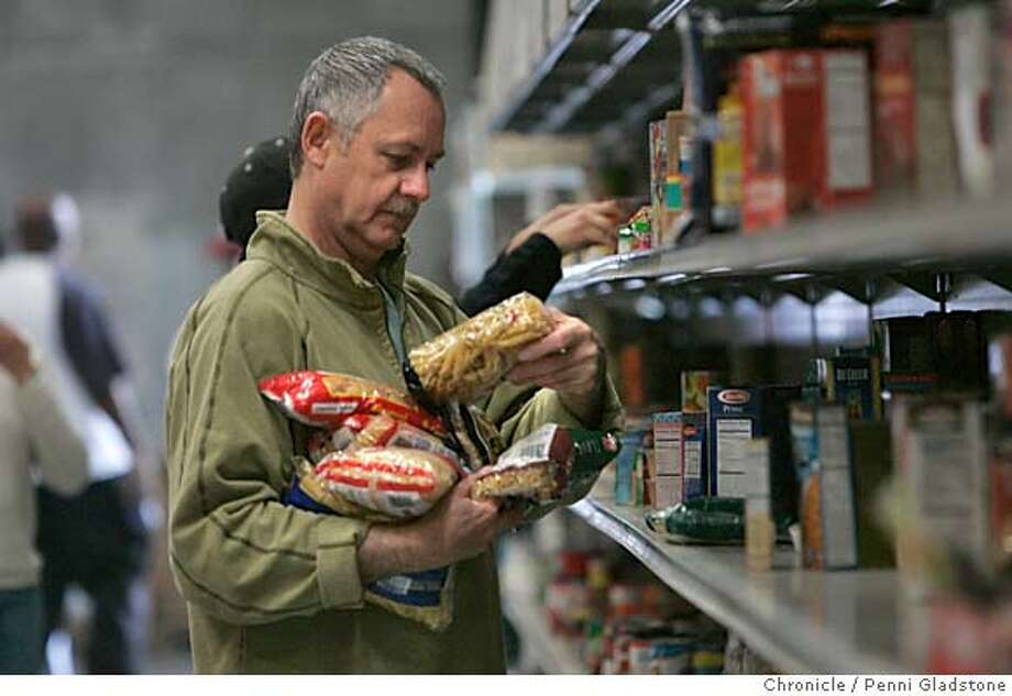 GIVING23061PG.JPG  Bob Flesher works for Cisco systems and is volunteering today.. he is putting food on the shelves that were donated by individuals.  donations for the holidays are down at the SF food bank.  Photo taken by Penni Gladstone/The San Francisco Chronicle  Photo taken on 11/23/04, in San Francisco, CA. Metro#Metro#Chronicle#11/23/2004#ALL#5star#b1#0422481047 Photo: Penni Gladstone