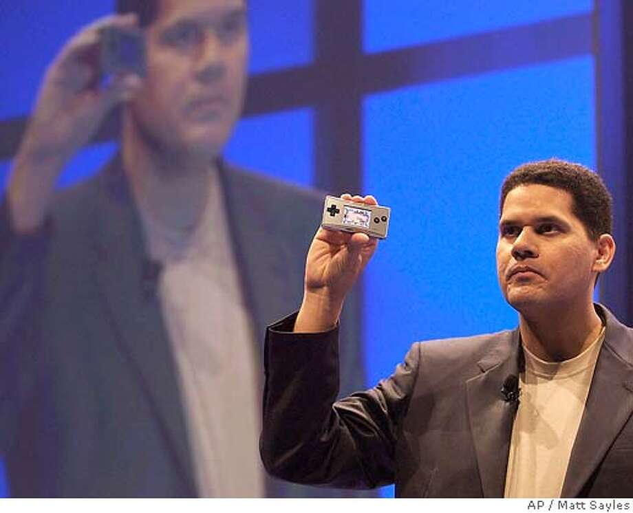 Reggie Fils-Aime, of America's Executive Vice President of sales & marketing, introduces the Game Boy Micro portable gaming console at the press conference in Los Angeles, Tuesday, May 17, 2005. (AP Photo/Matt Sayles) Photo: MATT SAYLES