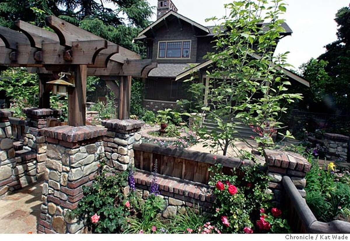 On 4/26/05 in Los Altos Debbie Segers recently designed garden including the front gate and rock walls pictured here was designed to complement the craftsmen-style architecture of the bungalow home.. Kat Wade/ The Chronicle