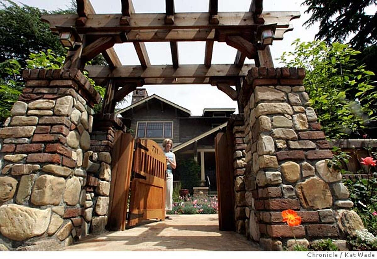 On 4/26/05 in Los Altos Debbie Segers recently designed garden including the front gate and rock walls pictured here was designed to complement the craftsmen-style architecture of the bungalow home. Kat Wade/ The Chronicle