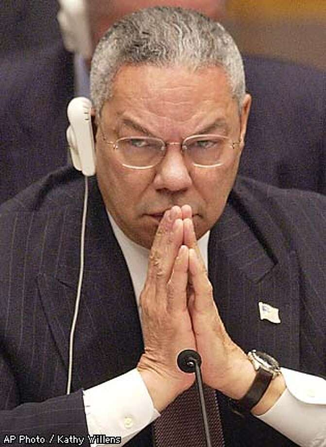 U.S. Secretary of State Colin Powell waits his turn to address a meeting of the United Nations Security Council, Friday, Feb. 14, 2003. (AP Photo / Kathy Willens) Photo: KATHY WILLENS