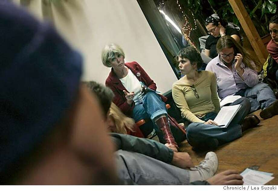 moveon22_061_ls.jpg  Kate Hilsenbeck (sitting in chair pointing finger) talks in the smaller groups during a Move On meeting, while facilitator Lisa Sock (brown shirt with glasses dangling from neckline) listens. MoveOn members across the country are holding parties to hear about what they've accomplished and to share thoughts on what is next.  City:� San Francisco, CA  Location:� 1045 17th St., Studio B, Potrero Hill  Event on 11/21/04 in San Francisco. Lea Suzuki / The Chronicle MANDATORY CREDIT FOR PHOTOG AND SF CHRONICLE/ -MAGS OUT Metro#Metro#Chronicle#11/22/2004#ALL#5star##0422479664 Photo: Lea Suzuki