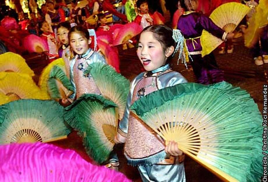 CHRISTINA KOCI HERNANDEZ/CHRONICLE  Ashley Liu,8, from West Portal Elementary School, in SF, enjoys the parade, as the performs Chinese folk dances with fans. Chinese New Year parade. Photo: CHRISTINA KOCI HERNANDEZ