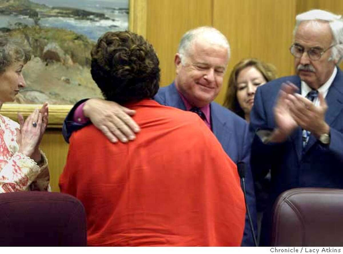 Don Perata of Oakland gives Martha Escutia of Los Angeles a hug as she introduces him as the new president pro tem, with outgoing president Senator John Burton on the right, in Sacramento Aug.24, 2004. LACY ATKINS/ The Chronicle MANDATORY CREDIT FOR PHOTOG AND SF CHRONICLE/ -MAGS OUT