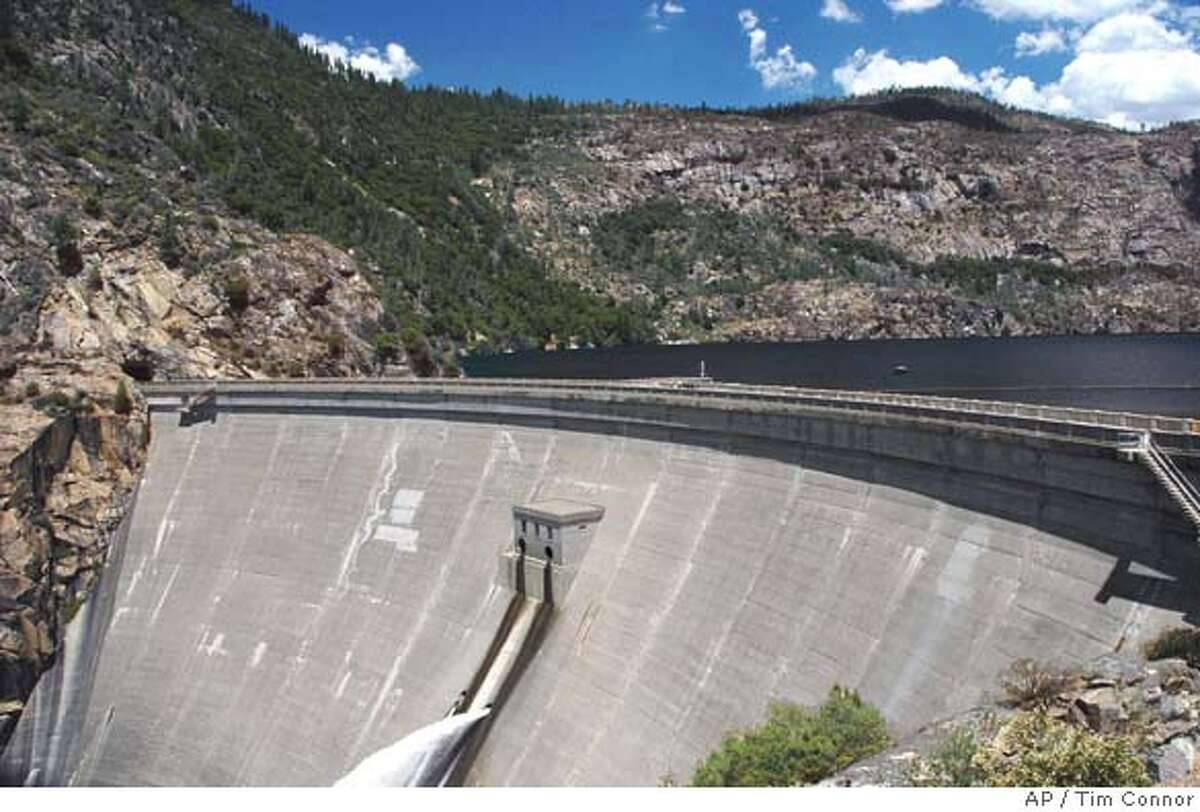 ** FILE ** This is a June 2004 file photo of O'Shaughnessy Dam in the Hetch Hetchy reservoir in Yosemite National Park, Calif. Of all the battles over natural resources in California, there have perhaps been none more quixotic than the effort by a small but growing number of environmentalists to tear down the dam in Yosemite National Park that for 80 years has provided power and drinking water to much of Northern California. A new report released Monday, Sept. 27, 2004, by Environmental Defense is thelatest attempt to sway public opinion in favor of draining Hetch Hetchy Valley, and restoring to nature what conservationist John Muir called Yosemite Valley's twin brother. (AP Photo/Environmental Defense, Tim Connor) Ran on: 10-01-2004 OShaughnessy Dam creates the Hetch Hetchy reservoir, which supplies San Francisco with water. A JUNE, 2004 PHOTO Metro#Metro#Chronicle#11/21/2004#ALL#5star##0422377245