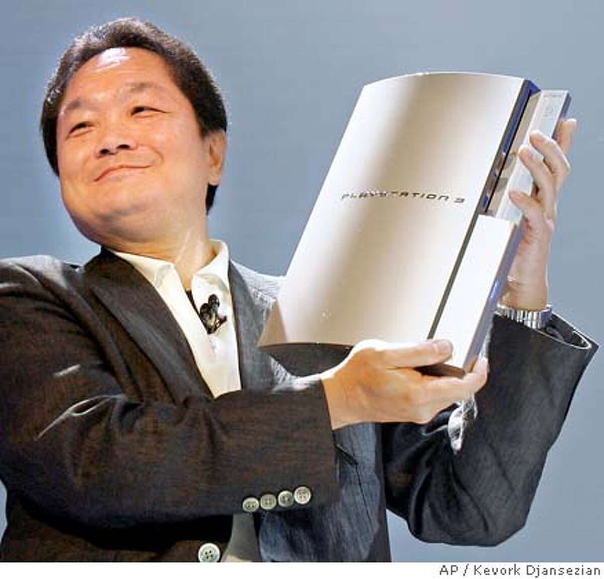 Ken Kutaragi, president and CEO of Sony Computer Entertainment Inc., holds up a prototype of the new Playsation 3 computer entertainment system during a news conference in Culver City, Calif., Monday, May 16, 2005. (AP Photo/Kevork Djansezian)