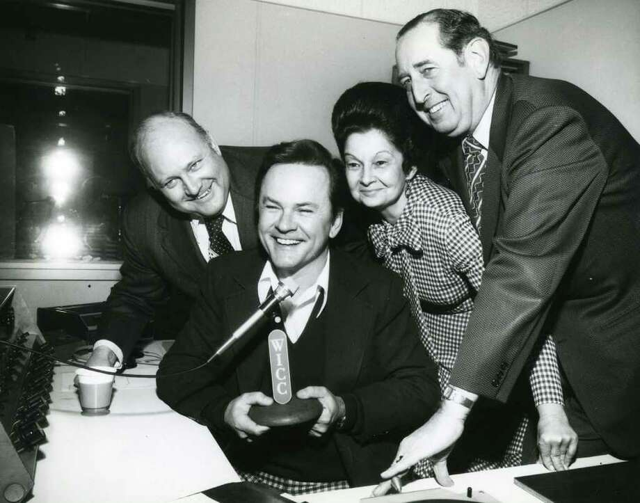 A photo Courtesy of the Bridgeport History Center at the Bridgeport Public Library shows Bob Crane in January 1976 when he paid a visit to WICC where he was a disc jockey in the early 1950s. From left are WICC sales director David Bodge, Crane, executive secretary Martha Gross and general manager Ray Colonari. Photo: Photo Courtesy Of The Bridgeport