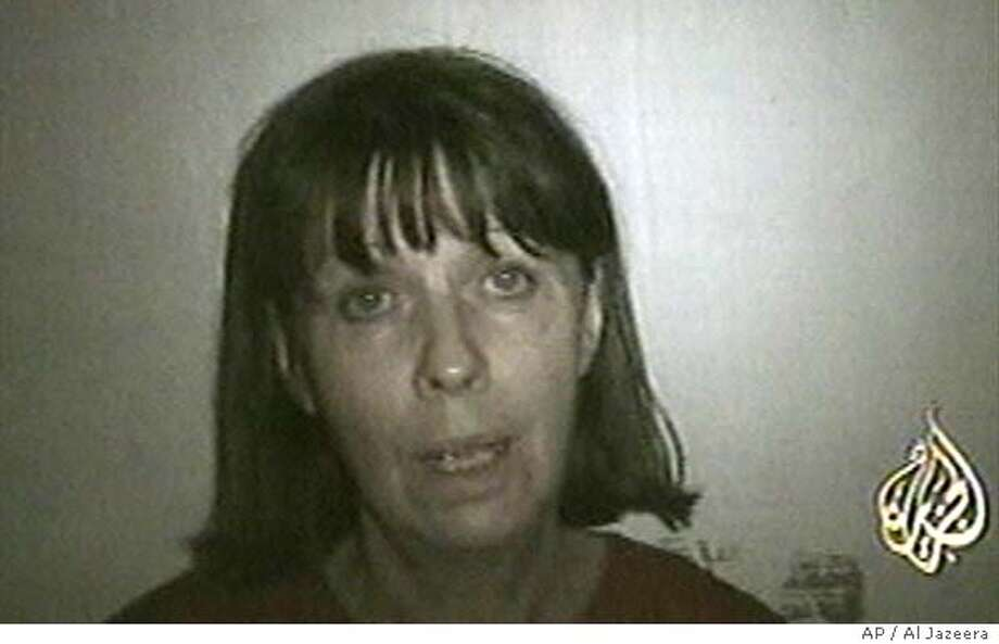 Margaret Hassan, the kidnapped British director of CARE International, is seen in this image made from an undated video aired on Al-Jazeera television Wednesday, Oct. 27, 2004. Hassan made another plea Wednesday urging Britain to withdraw troops from Iraq and asked for the release of all Iraqi female detainees. She also asked for the aid organization to close its offices in Iraq. CARE International has suspended its work in the country since her abduction Oct 19. (AP Photo/Al Jazeera via APTN) ** TV OUT ** TV OUT Ran on: 10-28-2004  Army Sgt. Jessie Jackson cries in pain while being evacuated after an attack north of Baghdad. Ran on: 10-28-2004  Army Sgt. Jessie Jackson cries in pain while being evacuated after an attack north of Baghdad. Ran on: 11-21-2004  Margaret Hassan pleads for her life in a video made by her captors before they allegedly killed her last week. Photo: AL JAZEERA