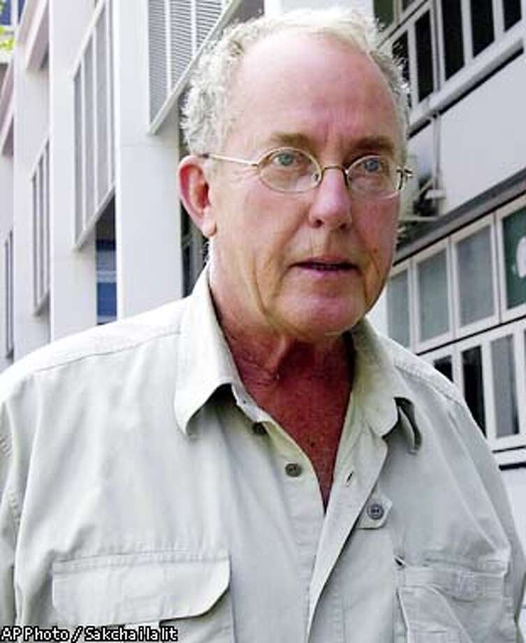 Thomas Frank White, a 67-year-old American from San Francisco, Calif., wanted in Mexico for allegedly molesting and raping minors, is being escorted by police from Thailand's crime suppression division to a Bangkok prison Thursday Feb. 13, 2003. He was arrested Tuesday evening in Bangkok and is awaiting an extradition hearing.(AP Photo / Sakchai lalit) Photo: SAKCHAI LALIT