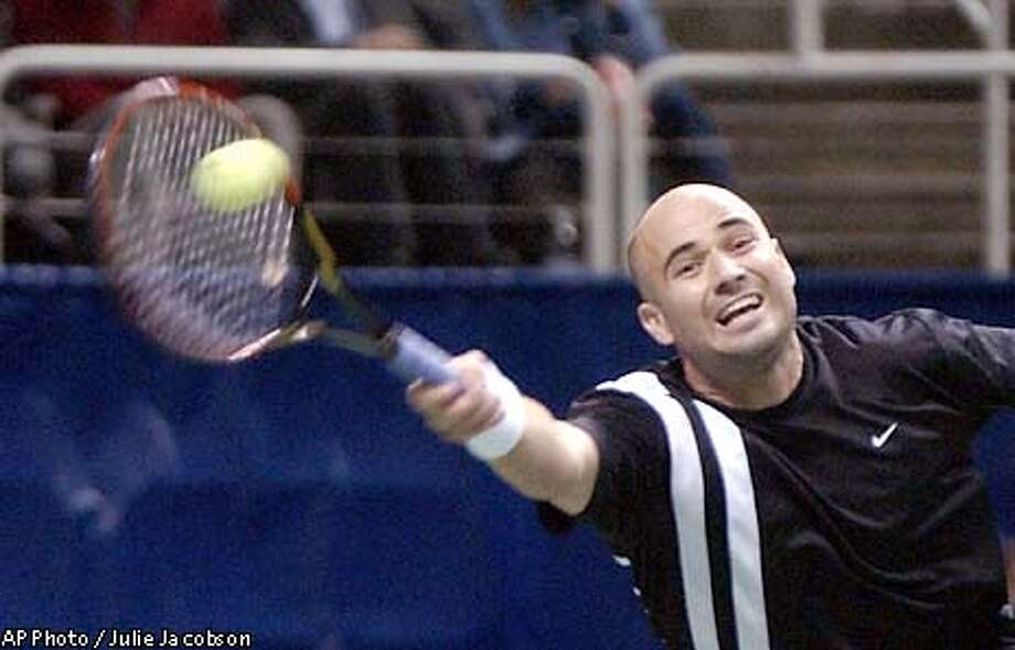 Andre Agassi lunges for a ball hit by Mark Philippoussis during the second round of the Thursday, Feb. 13, 2003, in San Jose, Calif. (AP Photo/Julie Jacobson) Photo: JULIE JACOBSON