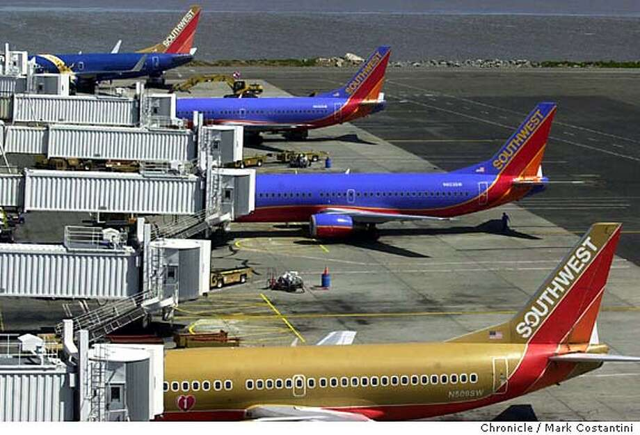 SOUTHWEST14_065.JPG Photo taken on 5/13/04 in OAKLAND.  Southwest planes at soon to be renovated terminal.  Business is doing a feature on the clout that Southwest Airlines, and its continuing expansion. SW is by far the largest airline. Oakland airport is extensively renovating its terminal 2, largely to please SW. Actual construction hasn't started yet, but this is a view of terminal 2 and the airfield in its present configuration of soon to be revamped terminal 2. Chronicle Photo By Mark Costantini MANDATORY CREDIT FOR PHOTOG AND SF CHRONICLE/ -MAGS OUT Travel#Travel#Chronicle#11/21/2004#ALL#Advance##0421763789 Photo: MARK COSTANTINI