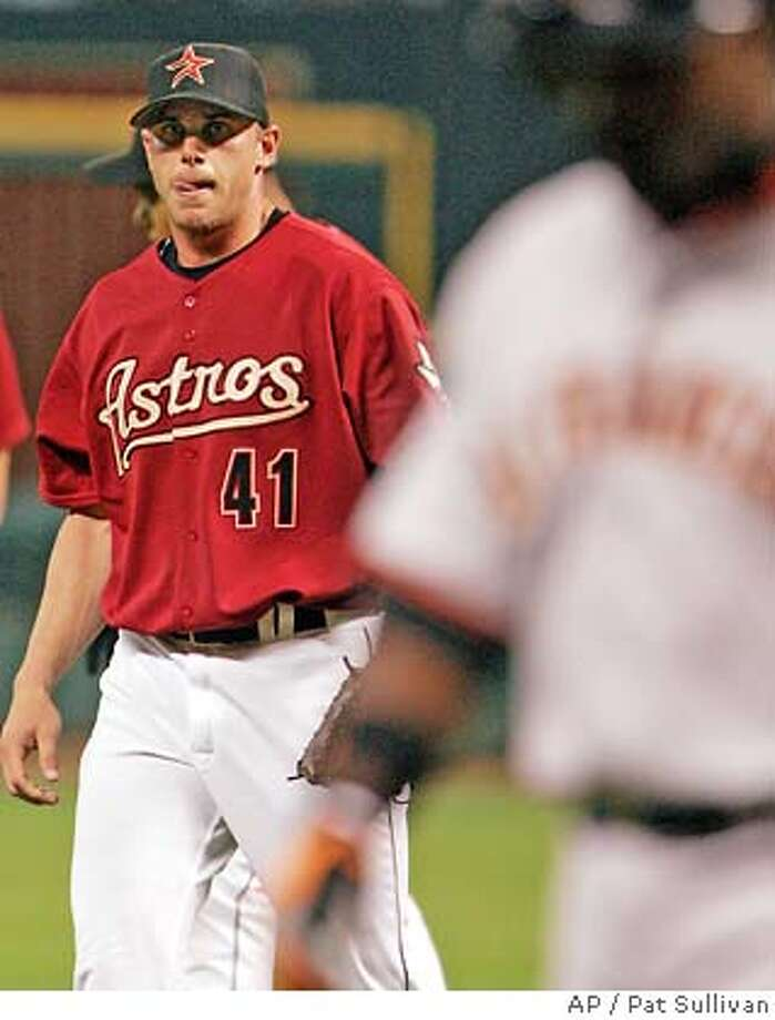Houston Astros starting pitcher Brandon Backe (41) licks his lips after pitching a complete shutout as the Astros beat the San Francisco Giants 9-0 Sunday, May 15, 2005 in Houston. Giants' Ray Durham, right, walks off the field after hitting the last out to Backe. (AP Photo/Pat Sullivan) Photo: PAT SULLIVAN