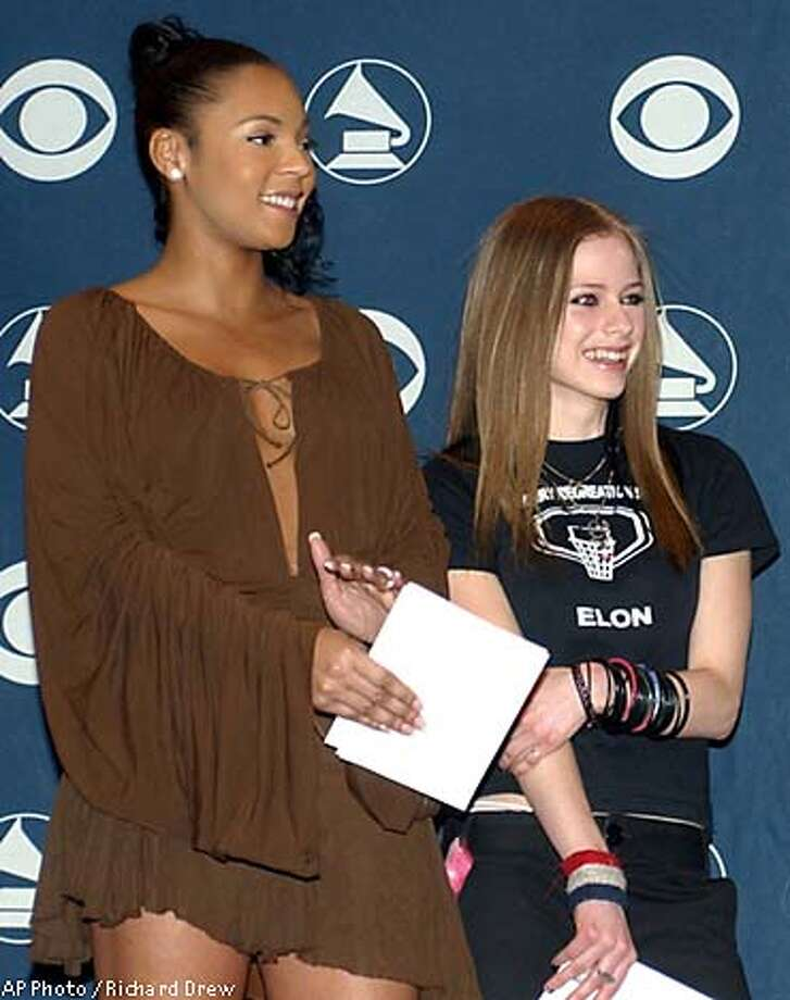 Best new artist Grammy nominees Ashanti, left, and Avril Lavigne. Associated Press photo by Richard Drew