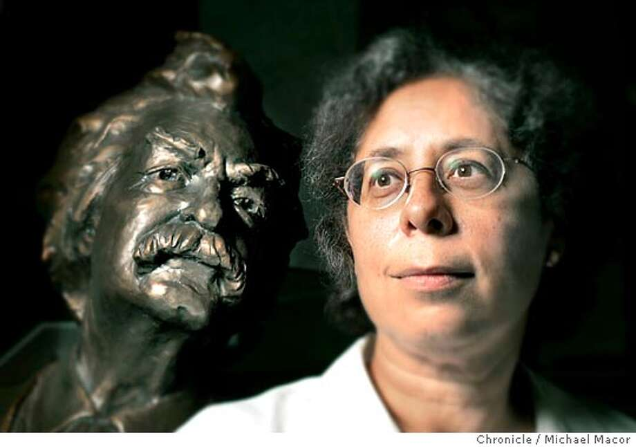 "Lin Salamo with a bronze sculpture of Twain that sits in the lobby of Bancroft Library. Salamo is the lead editor of a new book coming out in October, ""Mark Twain's Helpful Hints for Good Living"". Also Salamo is the Associate Editor of the ""Mark Twain Papers"" at UC Berkeley. She has worked with the writings for the past 34 years inside the Bancroft Library on the UC campus. 8/18/04 in Berkeley Michael Macor/San Francisco Chronicle Photo: Michael Macor"