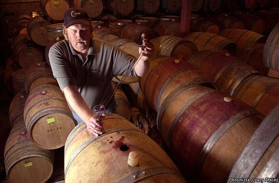Rick Rosenbrand, wine makr for V. Sattui Winery, checks the cabernat in the celler.  SAN FRANCISCO CHRONICLE/LACY ATKINS Photo: LACY ATKINS