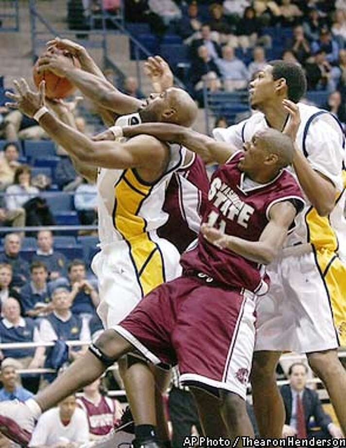 California's Brian Wethers, left and Gabriel Hughes, right, battle Washington State's Thomas Kelati, center, for the rebound during the first half in Berkeley, Calif., Thursday, Feb. 13, 2003. (AP Photo / Thearon Henderson) Photo: THEARON HENDERSON