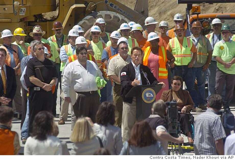 Gov. Arnold Schwarzenegger speaks at a news conference where he talked about plans to increase transportation spending by $1.3 billion Thursday, May 12, 2005, in Pittsburg, Calif., while standing on the future Highway 4 expansion under construction. (AP Photo/Contra Costa Times, Nader Khouri) NO MAGS, , NO ARCHIVE, NO INTERNET, NO TELEVISION, BAY AREA CREDIT Photo: NADER KHOURI