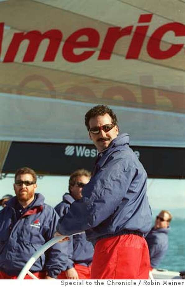 AMERICAONE2/C/18NOV98/MN/RW Captian Paul Cayard of America One steers the sailboat during practice on the Bay as he and his team prepare for the big race in New Zealand. BY ROBIN WEINER/THE CHRONICLE Ran on: 11-21-2004  Paul Cayard relished walking in the opening ceremonies in Athens, and getting his family into the athletes' village. Ran on: 11-21-2004  Paul Cayard relished walking in the opening ceremonies in Athens, and getting his family into the athletes' village. Photo: ROBIN WEINER