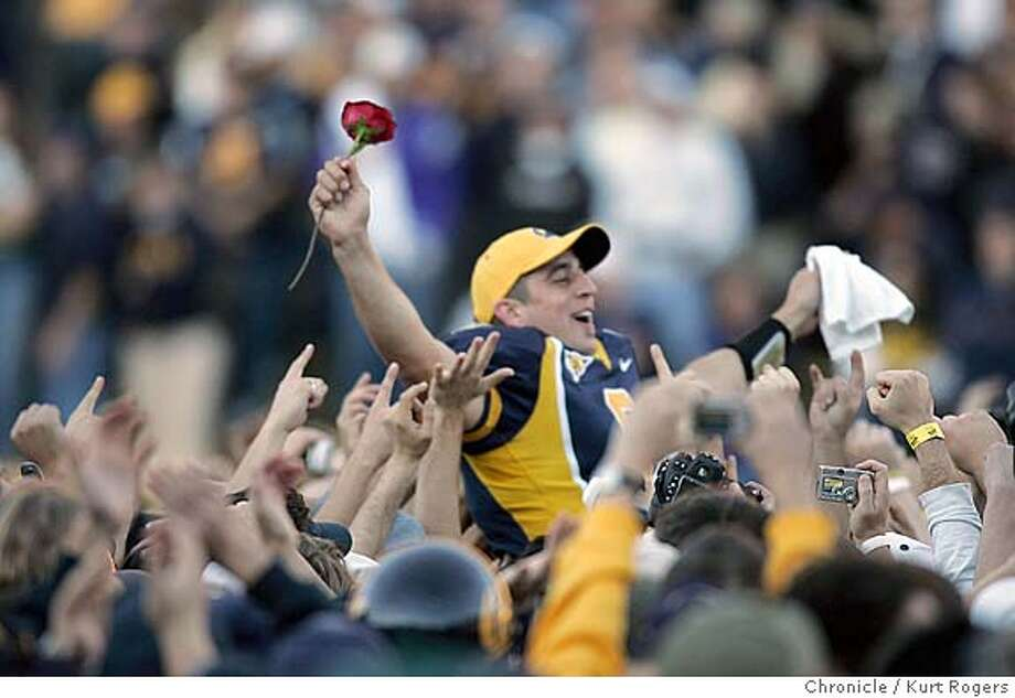 Aaron Rodgers was taken off the field on the arms of fans.  The 107th Big game at Cal the Cal Bears beat the Stanford Cardinals 41-6. 11/20/04 in Berkeley,CA.  KURT ROGERS/THE CHRONICLE Photo: KURT ROGERS