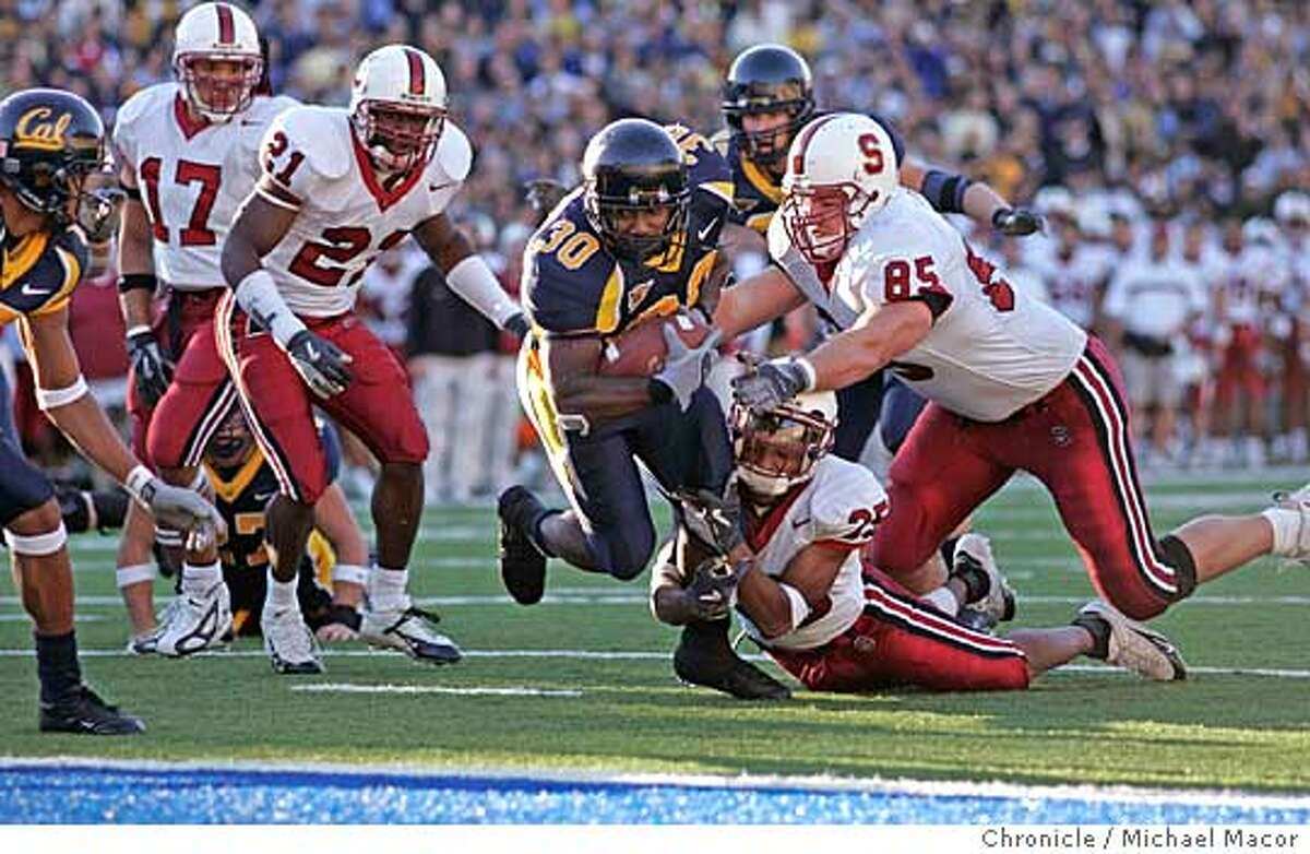 biggame_009_mac.jpg Ca's 30- J.J. Harrington surges into the endzone on a 9 yard in the start of the 4th quarter. Stanford's 25-Calvin Armstrong and 85-Will Svitek can't make the stop. The 107th Big Game, Stanford and Cal College Football. Cal keeps the