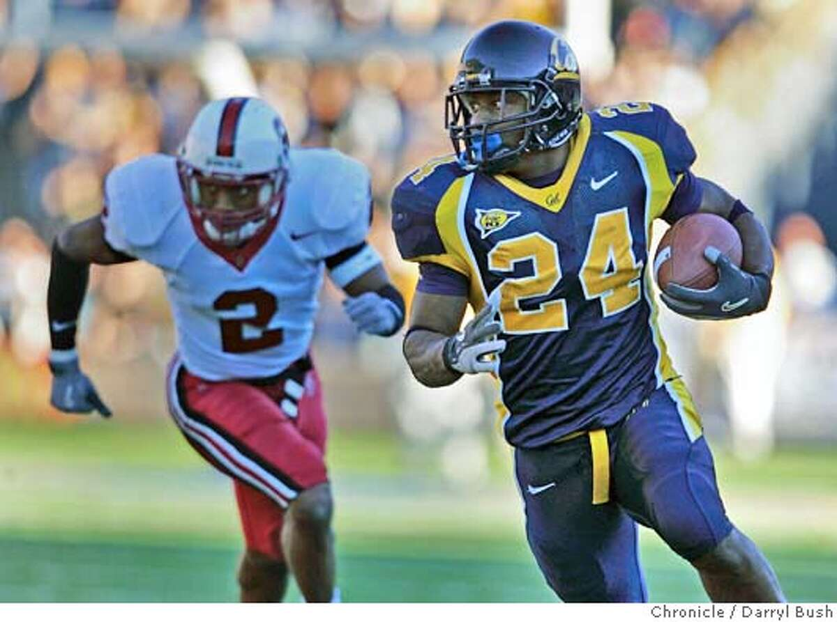 biggame_002_db.jpg California Golden Bears Marshawn Lynch runs for a touchdown in the 3rd qtr. as Stanford Cardinals Stanley Wilson (2) pursues in football Big Game at Memorial Stadium. 11/20/04 in Berkeley Darryl Bush / The Chronicle