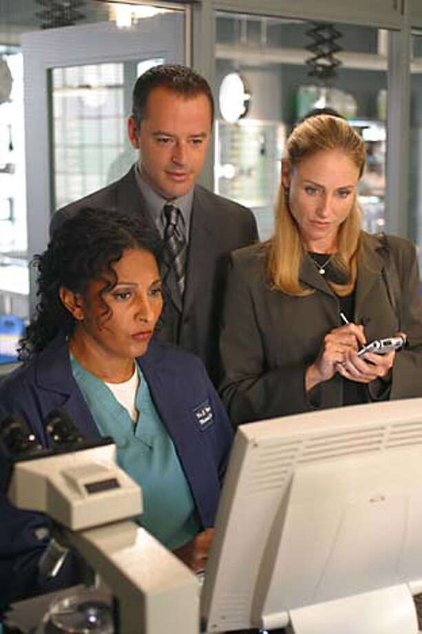 """Tracy Pollan, right, stars with Pam Grier and Gil Bellows in """"1st to Die."""""""