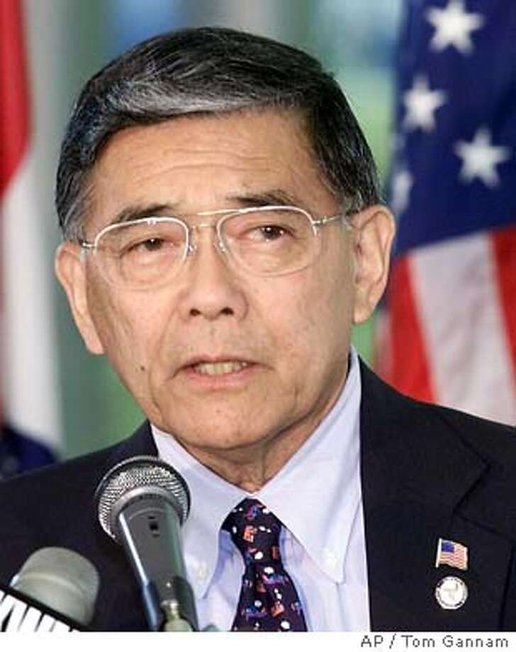 U.S. Secretary of Transportation Norman Mineta answers questions from the media about air safety after a news conference announcing a $17.6 million grant for Lambert International Airport, Thursday, May 16, 2002, at the airport in St. Louis. Mineta also addressed reports that the Bush Administration had advance warnings of potential attacks by Osama bin Laden's terrorist network. (AP Photo/Tom Gannam) Photo: TOM GANNAM