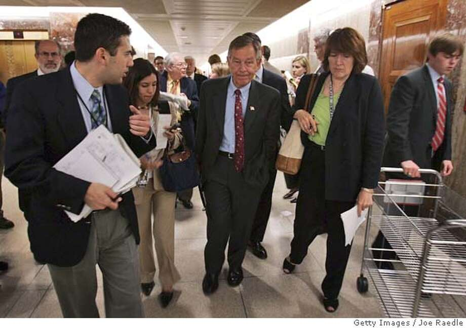 WASHINGTON - MAY 12: Sen. George Voinovich (R- Ohio) (C) walks through a group of reporters as he leaves the Senate Foreign Relations Committee hearing on Capitol Hill May 12, 2005 in Washington, DC. The committee voted to move the decision on U.N. nominee John Bolton to the Senate floor without their recommendation. (Photo by Joe Raedle/Getty Images) *** Local Caption *** George Voinovich Photo: Joe Raedle