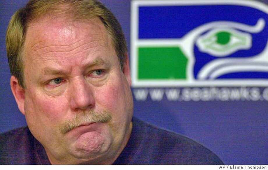 Seattle Seahawks coach Mike Holmgren speaks at a news conference Tuesday, Jan. 8, 2002, in Kirkland, Wash., one day after his team was eliminated from the playoffs. Holmgren said that he's thinking about offering Trent Dilfer a new contract that would give Dilfer a chance to dislodge Matt Hasselbeck as the starting quarterback next season. The Seahawks (9-7) saw their season end Monday night when the Baltimore Ravens beat the Minnesota Vikings to claim the final AFC wild-card playoff berth. (AP Photo/Elaine Thompson) CAT DIGITAL IMAGE Sports#Sports#Chronicle#11/21/2004#ALL#2star##422130051 Photo: ELAINE THOMPSON