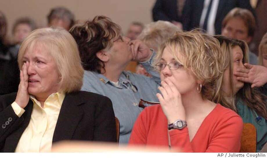 Teri Crawford, left, and her daughter Jennifer Curtis react, Friday, Nov. 19, 2004, in the front row of a courtroom while Leatha Shropshire, second row left, and daughter Veronica Lively turn their backs as Ray Brent Marsh reads a prepared statement to the courtroom in LaFayette Ga. Marsh, a former crematory operator, pleaded guilty Friday to dumping 334 bodies and giving the families of the deceased cement dust instead of ashes. Crawford was among those who had a loved one sent to the crematory.(AP Photo/The Times Free Press, Juliette Coughlin) , NO MAGS, INTERNET OUT, MANDATORY CREDIT Nation#MainNews#Chronicle#11/20/2004#ALL#5star##0422475873 Photo: JULIETTE COUGHLIN