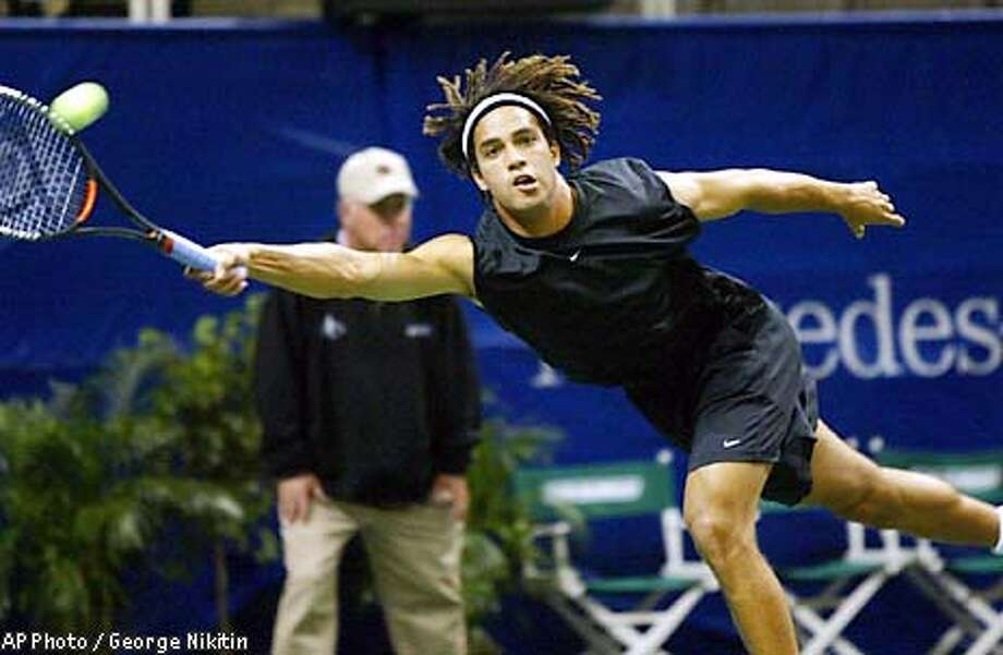 Third seed James Blake lunges for a forehand against Wayne Black in first-round play at the , Wednesday, Feb. 12, 2003, at the HP Pavilion in San Jose, Calif. (AP Photo/George Nikitin) Photo: GEORGE NIKITIN