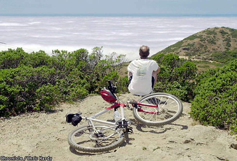 The climb to the top of Montara Mountain, whether by foot or by mountain bike, is well worth the views of the Pacific Ocean. Chronicle photo, 2001, by Chris Hardy