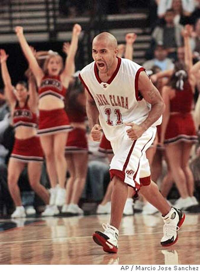 Santa Clara's Kyle Bailey (11) celebrates after hitting a three-point basket against North Carolina in the second half during the Pete Newell Challenge on Friday, Nov. 19, 2004 in Oakland, Calif. Santa Clara won 77-66. (AP Photo/Marcio Jose Sanchez) Sports#Sports#Chronicle#11/20/2004#ALL#5star##0422476372 Photo: MARCIO JOSE SANCHEZ