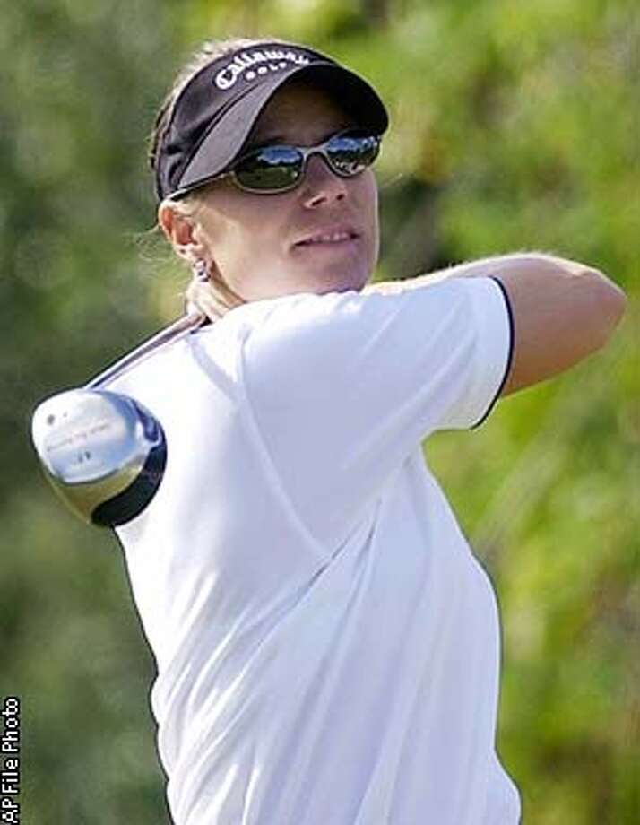 ** FILE ** Annika Sorenstam of Sweden tees off the third tee during the final round of the ADT Championship at the Trump International Golf Club in West Palm Beach, Fla., in this Nov. 24, 2002 photo. Sorenstam could be offered an exemption to the Colonial and become the first woman in 58 years to play on the PGA Tour, a magazine reported Monday Feb. 11, 2003. (AP Photo/Steve Mitchell) Photo: STEVE MITCHELL