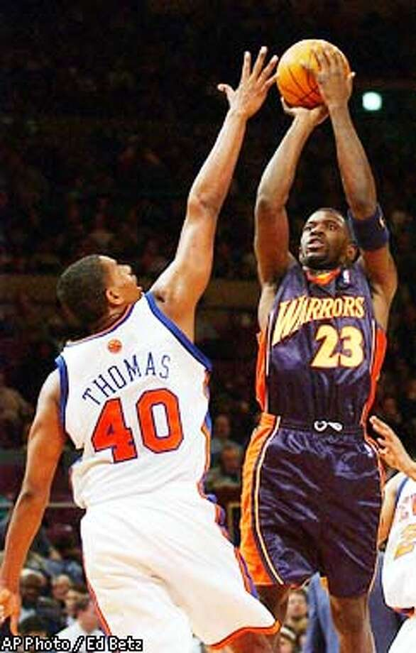 Golden State Warriors' Jason Richardson shoots over New York Knicks' Kurt Thomas during the third quarter at Madison Square Garden in New York, Wednesday, Feb 12, 2003. The Warriors defeated the Knicks 113-107. (AP Photo/Ed Betz) Photo: ED BETZ