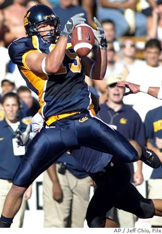 California wide receiver Chase Lyman catches a 25-yard touchdown against New Mexico State in the second quarter in Berkeley, Calif., on Saturday, Sept. 11, 2004. California won 41-14. Lyman had four receptions for 111 yards. (AP Photo/Jeff Chiu) Ran on: 09-12-2004  The largest crowd for a home opener in Cal history, 58,949, was treated to three TDs and 177 yards by J.J. Arrington. Photo: JEFF CHIU