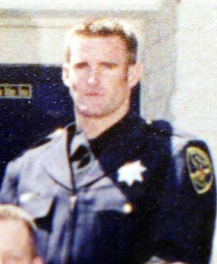 Alex Fagan jr., 23, appears in his police academy graduate photo which is hanging in the Police Department Hall of Justice San Francisco, CA. Handout Photo: Handout