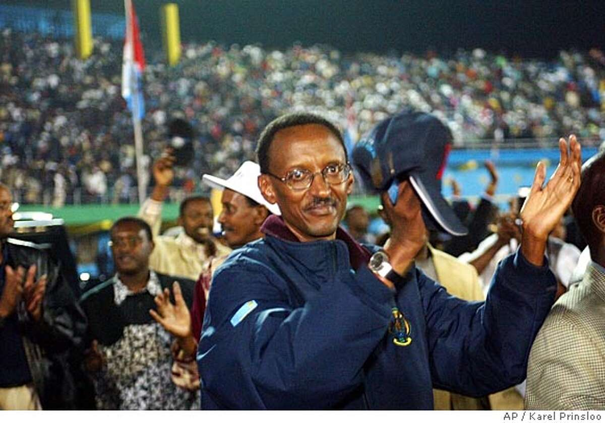 Rwandan President Paul Kagame, leader of the Rwandan Patriotic Front (RPF), greets a crowd of supporters during a post election party in the early hours of Tuesday, Aug 26, 2003 at the Kigali stadium. With 51 of the 106 districts reporting, Kagame had 94.3 percent of the vote to 3.5 percent for his main competitor, Faustin Twagiramungu. (AP Photo/Karel Prinsloo) CAT 4p11 ng w/ 3 rwanda