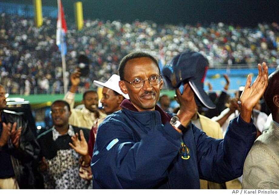 Rwandan President Paul Kagame, leader of the Rwandan Patriotic Front (RPF), greets a crowd of supporters during a post election party in the early hours of Tuesday, Aug 26, 2003 at the Kigali stadium. With 51 of the 106 districts reporting, Kagame had 94.3 percent of the vote to 3.5 percent for his main competitor, Faustin Twagiramungu. (AP Photo/Karel Prinsloo) CAT 4p11 ng w/ 3 rwanda Photo: KAREL PRINSLOO