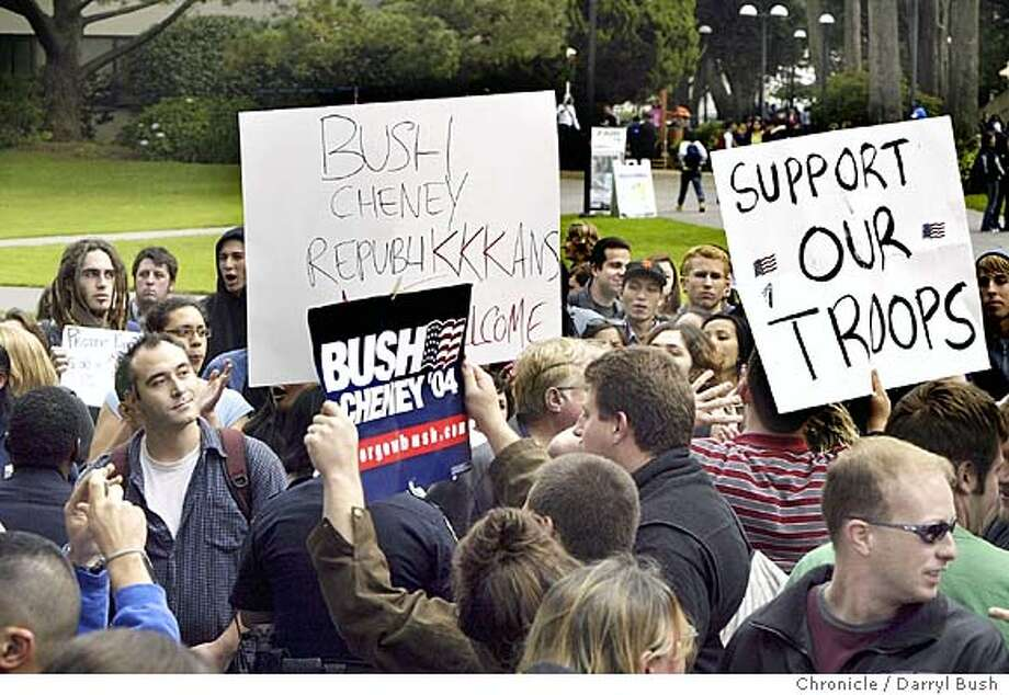 "sfstate_079_db.jpg  Students protesting against President Bush with signs (large white sign) clash with a small group of students that are, ""college republicans,"" holding their own signs, ""Bush Cheney,"" and ""support our troops,"" on campus at San Francisco State University.  11/3/04 in San Francisco  Darryl Bush / The Chronicle MANDATORY CREDIT FOR PHOTOG AND SF CHRONICLE/ -MAGS OUT Insight#Insight#Chronicle#11/21/2004##2star##0422450161 Photo: Darryl Bush"