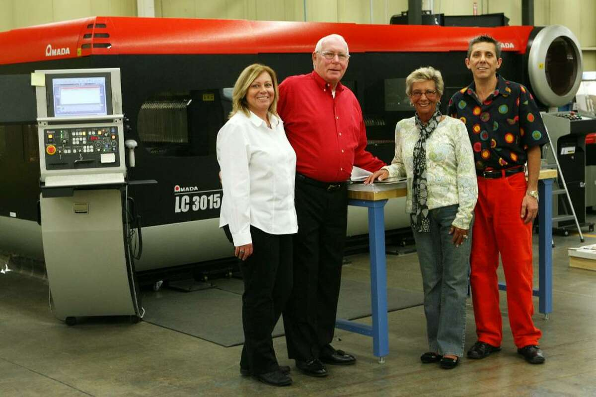 Members of the Pohl Family, from left to right, Lisa, Ed, Cindy, and Brian, celebrate the grand opening on Oct. 30, 2009 of the new location on Bic Dr. of their Milford Fabricating Company. The Pohl family has operated the company since 1947 and suffered a fire in their Erna Ave. location in March.
