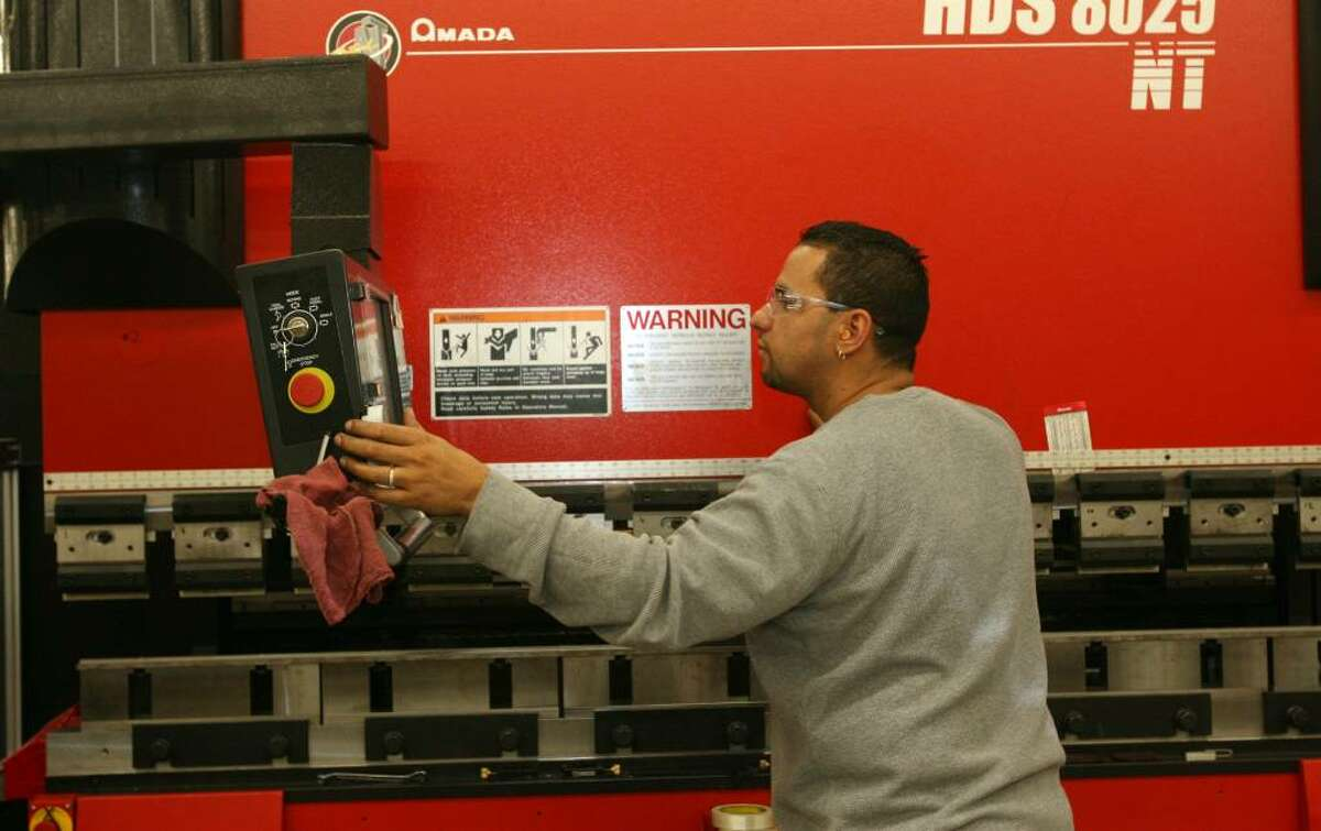Nick Rodriguez works the press break machine in the new Milford Fabricating Co. location on Bic Dr. The Pohl family celebrated the grand opening on Oct. 30, 2009. They have operated the company since 1947 and suffered a fire in their Erna Ave. location in March.