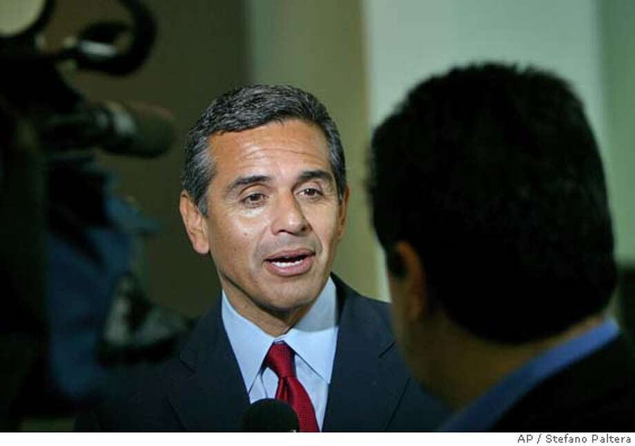 Mayoral candidate Antonio Villaraigosa gives an interview at the 10th Council District Senior Convention and Health Care Expo held Saturday, May 07, 2005 at the Convention Center in Los Angeles. In the final days of the race for mayor, the TV images being broadcast by Mayor James Hahn and challenger Antonio Villaraigosa depict a world so corrupt its hard to figure out where one scandal starts and another one ends. (AP Photo/Stefano Paltera) Photo: STEFANO PALTERA