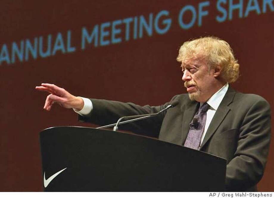 ** FILE ** Phil Knight, Nike Inc. chairman, introduces gestures at Nike's 2003 annual meeting of shareholders in Portland, Ore., Monday, Sept. 22, 2003. Phil Knight stepped down Thursday, Nov. 18, 2004, as president and chief executive officer of Nike Inc., the $12 billion athletic shoe and clothing company he co-founded. Knight, 66, will remain as chairman of the company's board of directors, the company said. (AP Photo/Greg Wahl-Stephens) SEPT. 22, 2003, PHOTO Business#Business#Chronicle#11/19/2004#ALL#5star##0422473894 Photo: GREG WAHL-STEPHENS