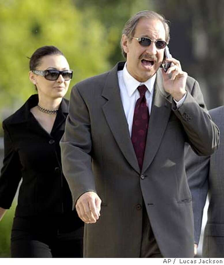 Mark Geragos, former attorney for Michael Jackson, talks on his cell phone as he arrives at the Santa Barbara County courthouse, as a defense witness, in Jackson's child molestation trial Friday, May 13, 2005, in Santa Maria, Calif. (AP Photo/Lucas Jackson, Pool) POOL PHOTO Photo: LUCAS JACKSON