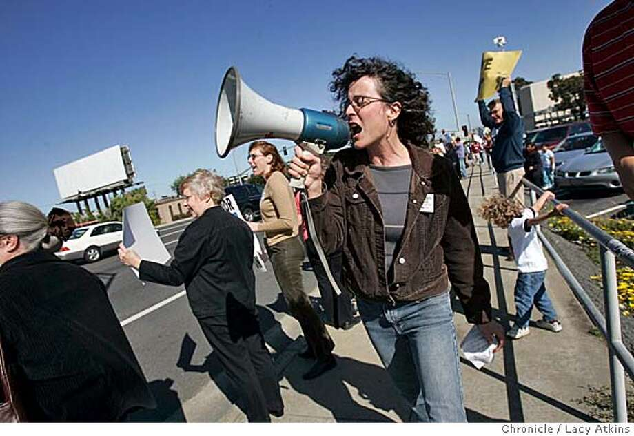 TEACHERS_094_la.JPG  Clare Jackson, teacher at Alta Loma Middle School leads the protestors in a chant against Govenor Schwarzeneggger's education policies, at the corner of El Camino Real, in Daly City, Wed. May 11, 2005. 40-mile El Camino Picket: Hundreds of teachers picketing the governor's education policies will be out on various corners after 3:30 p.m. Wednesday along a 40-mile stretch of El Camino Real, starting in Daly City and ending in Sunnyvale.  5/11/05 LACY ATKINS  San Francisco Chronicle Photo: LACY ATKINS